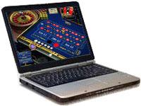 Un laptop con sullo schermo un'immagine di tavolo da roulette.